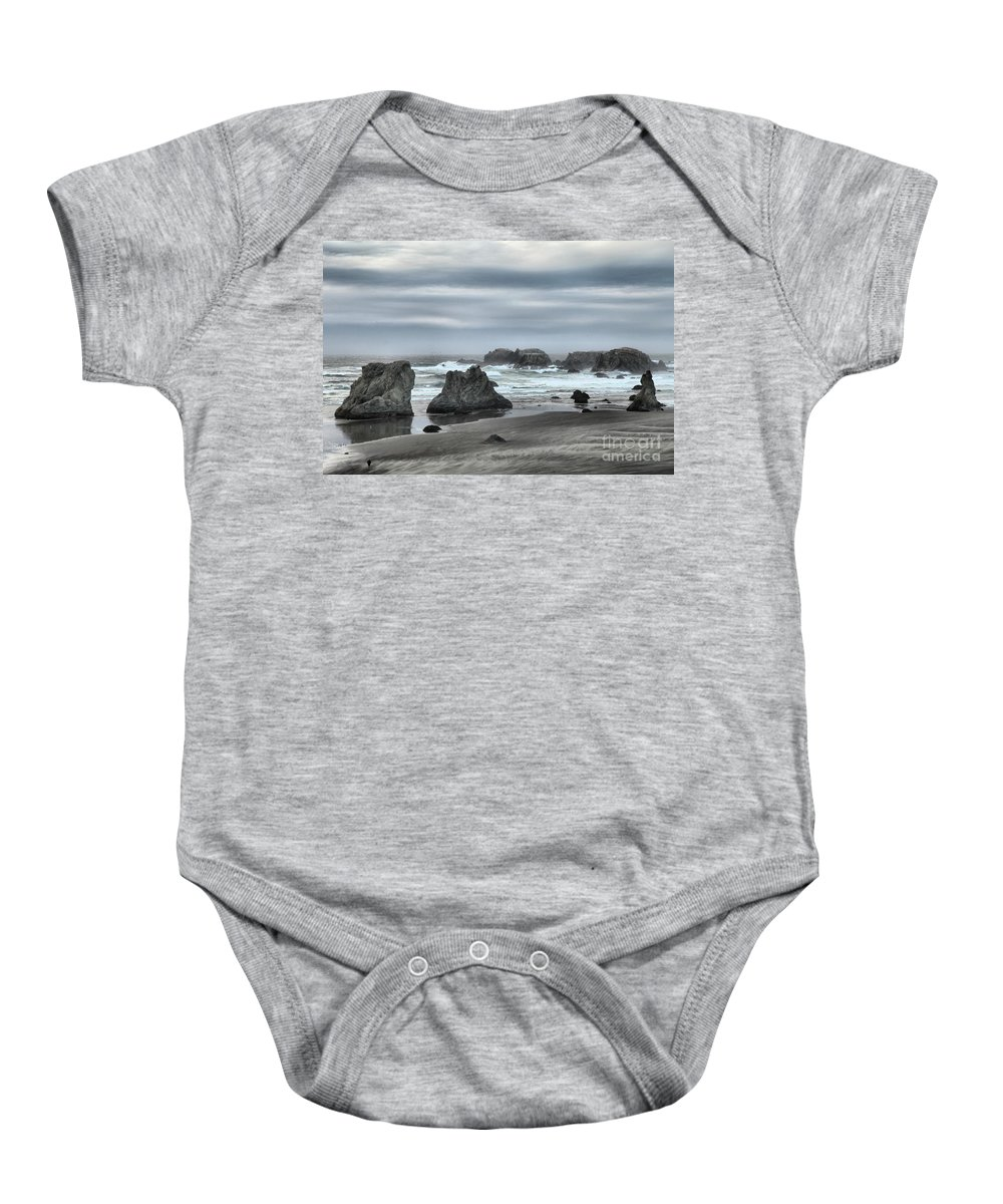 Bandon Beach Baby Onesie featuring the photograph The Little Jogger by Adam Jewell