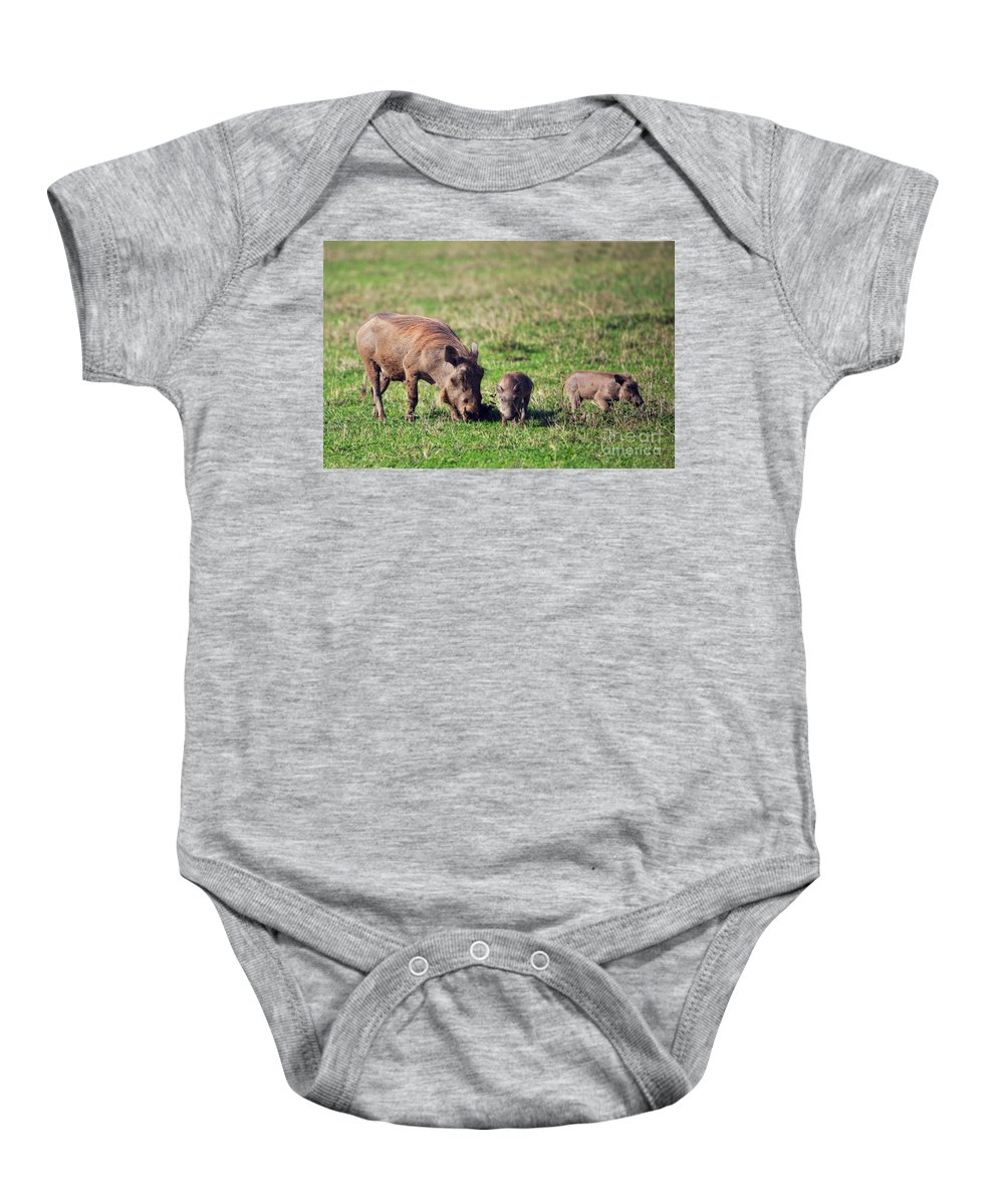 Warthog Baby Onesie featuring the photograph The Warthog Family On Savannah In The Ngorongoro Crater. Tanzania by Michal Bednarek