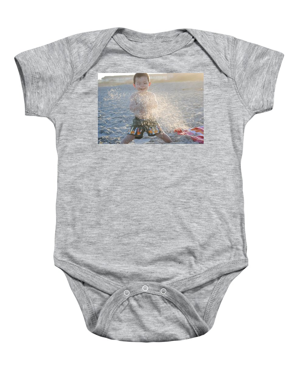 Boy Baby Onesie featuring the photograph Throwing Sand by Saralyn Cumberledge
