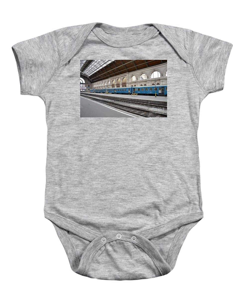 Train Baby Onesie featuring the photograph Train At Station Platform Budapest Hungary by Imran Ahmed
