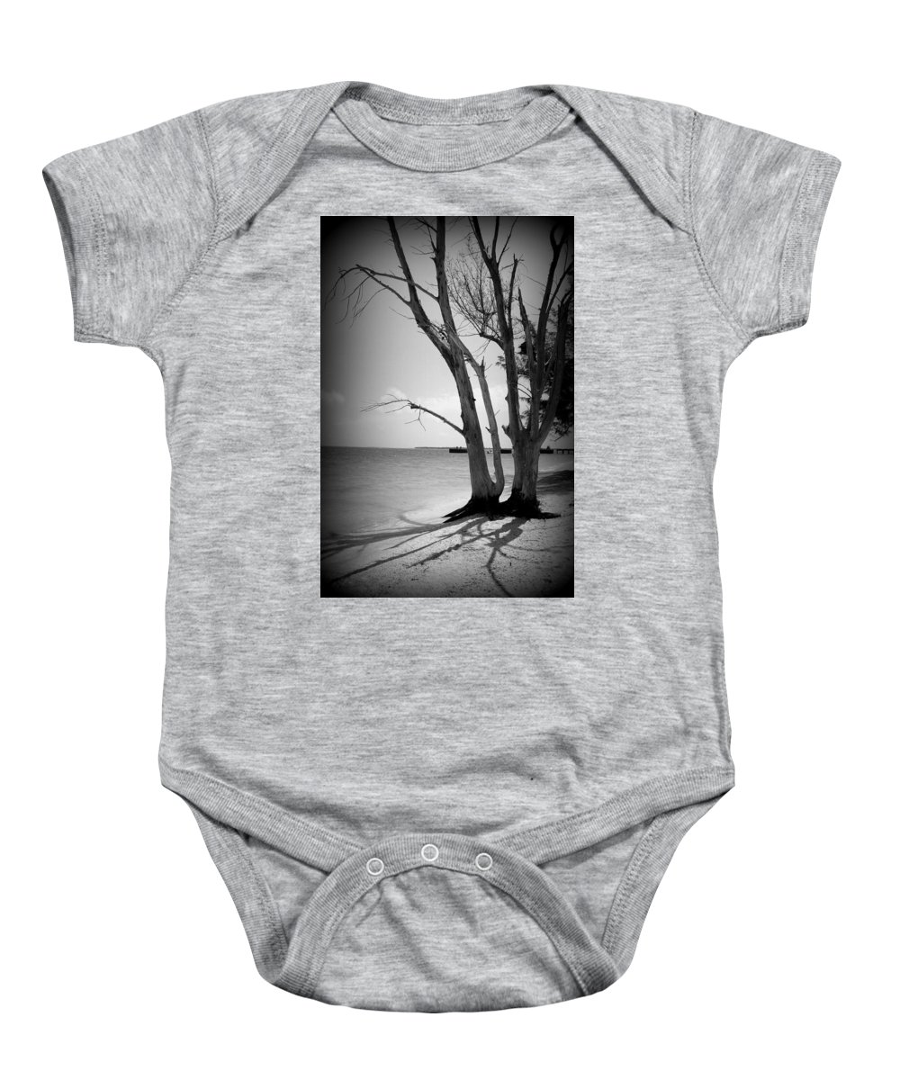 Tree Baby Onesie featuring the photograph Tree By The Sea by Laurie Perry