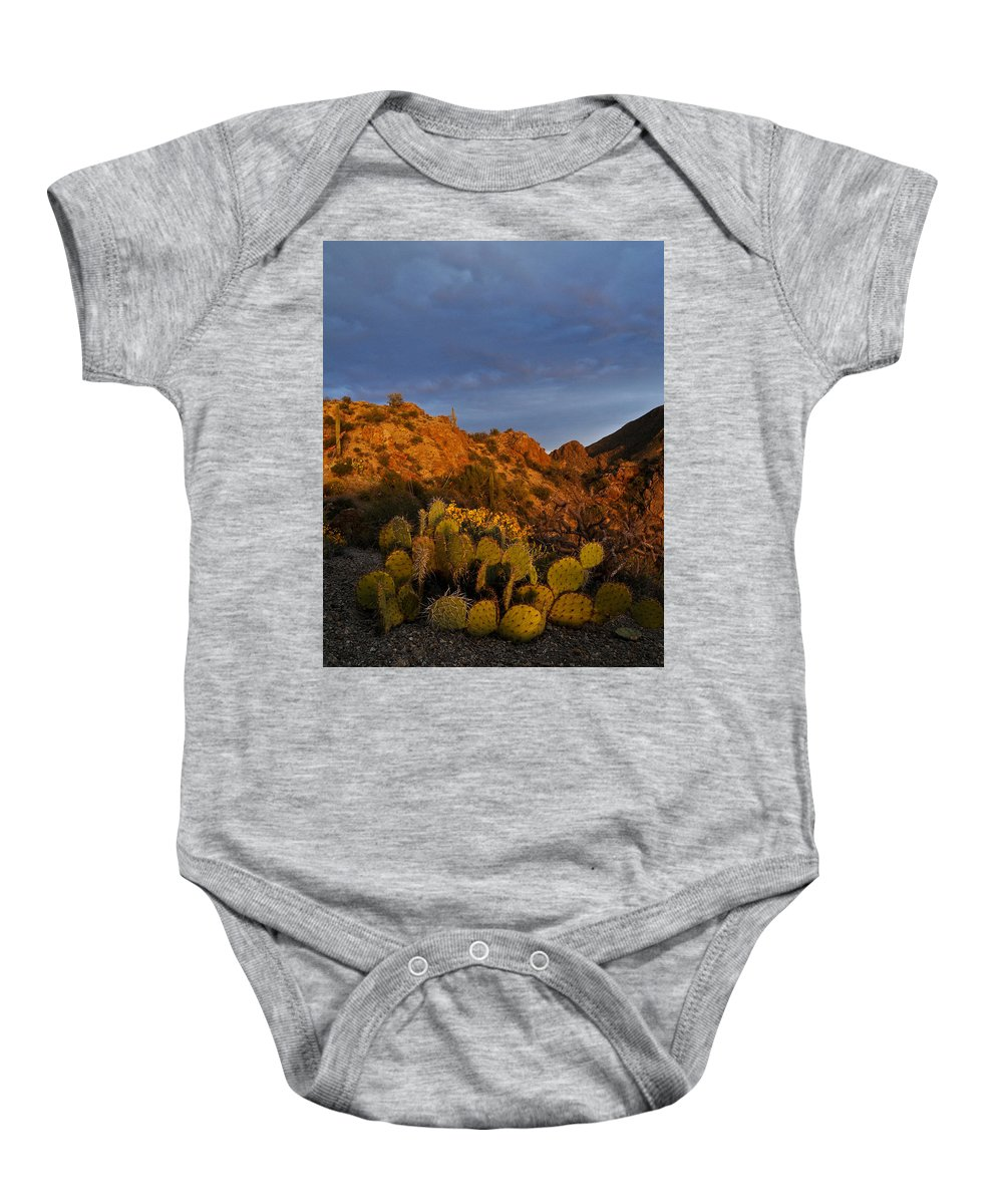 Sunset Baby Onesie featuring the photograph Trickle Of Light by Geoffrey Bolte