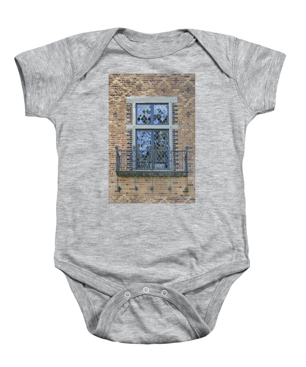 Tudor Baby Onesie featuring the photograph Tudor Style Windows With Balcony by Jit Lim