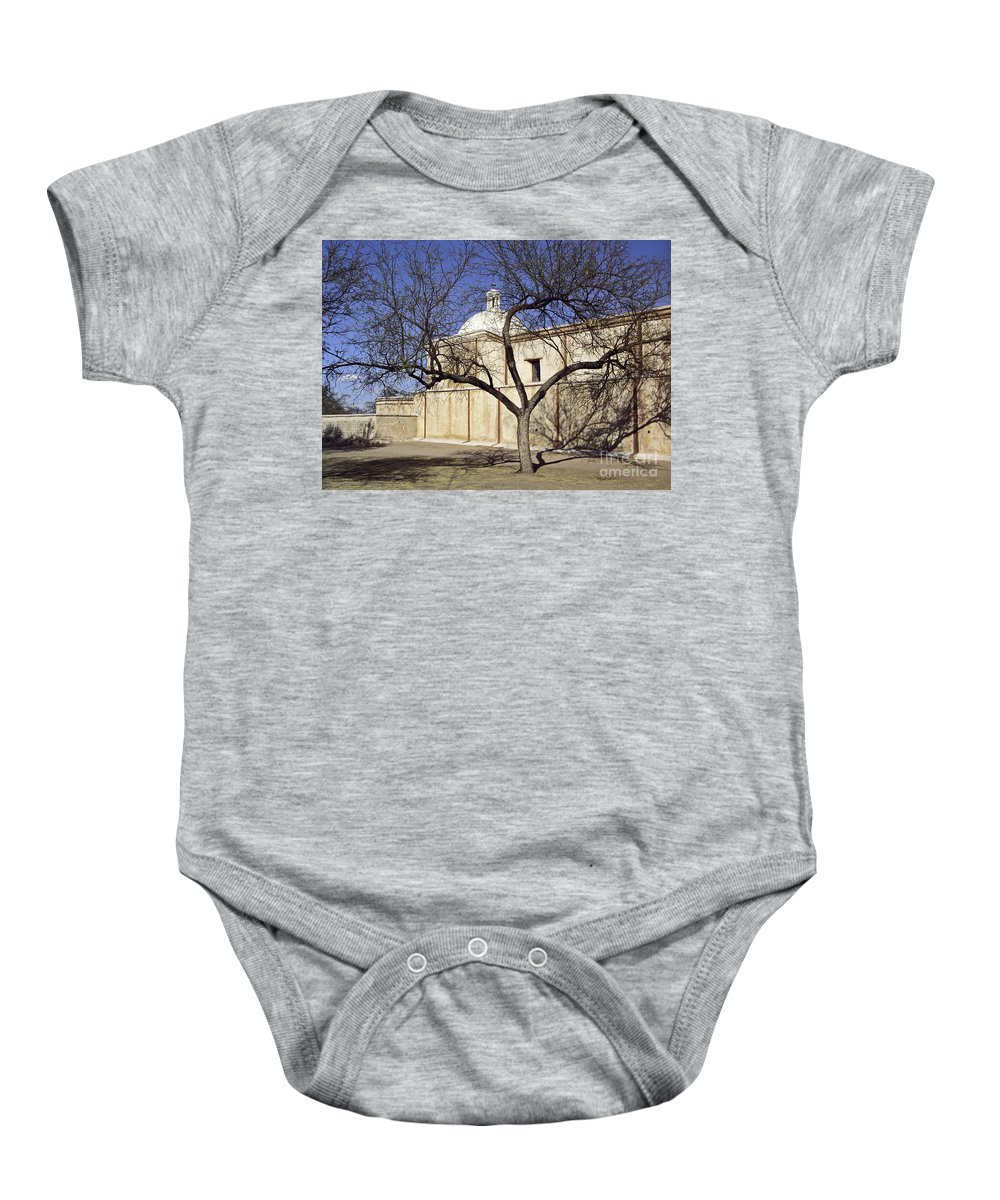 Mission Baby Onesie featuring the photograph Tumacacori with Tree by Kathy McClure