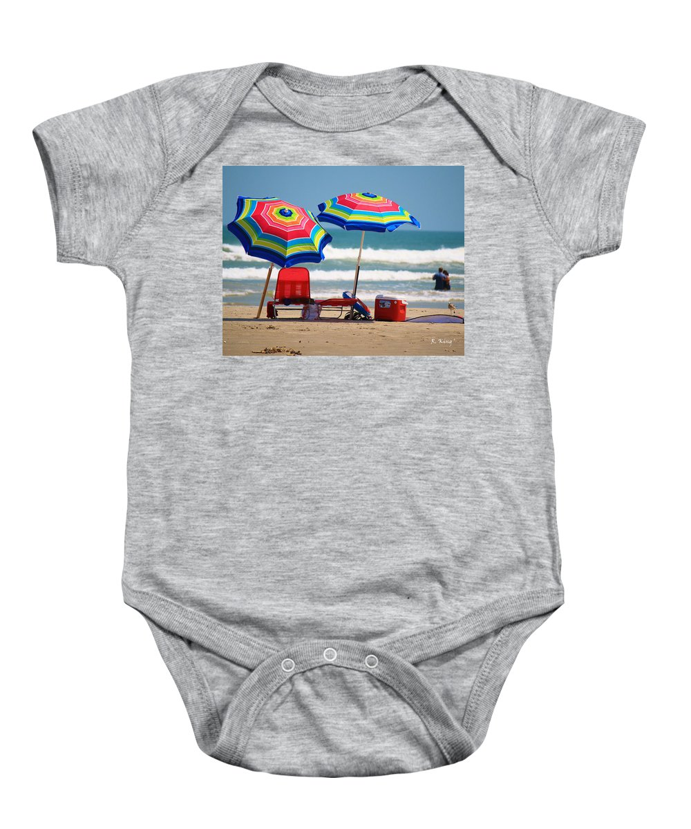 Roena King Baby Onesie featuring the photograph Two Umbrellas On The Beach In Texas by Roena King