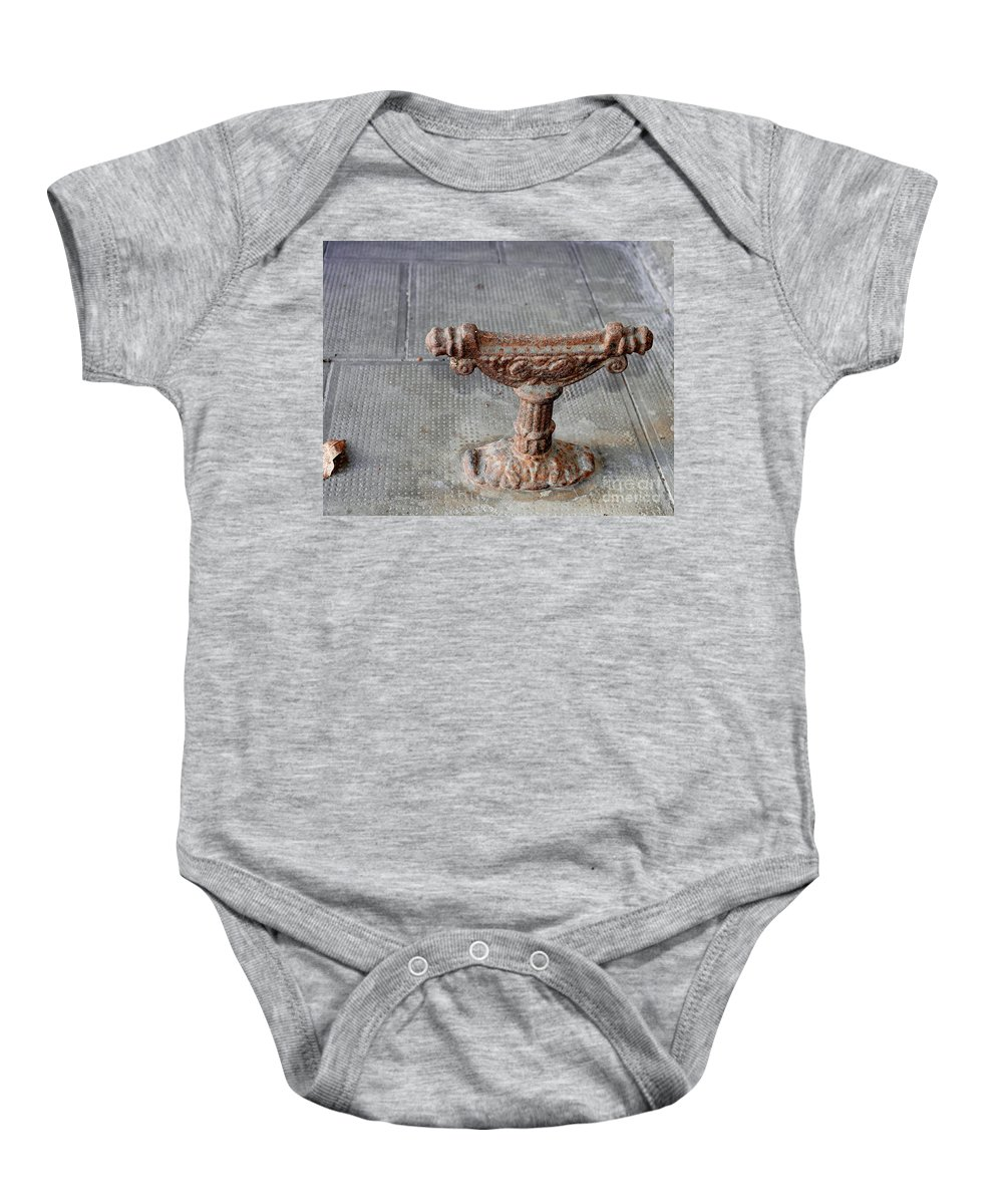 Iron Boot Scrape Baby Onesie featuring the photograph Vintage Iron Work by Felicia Tica