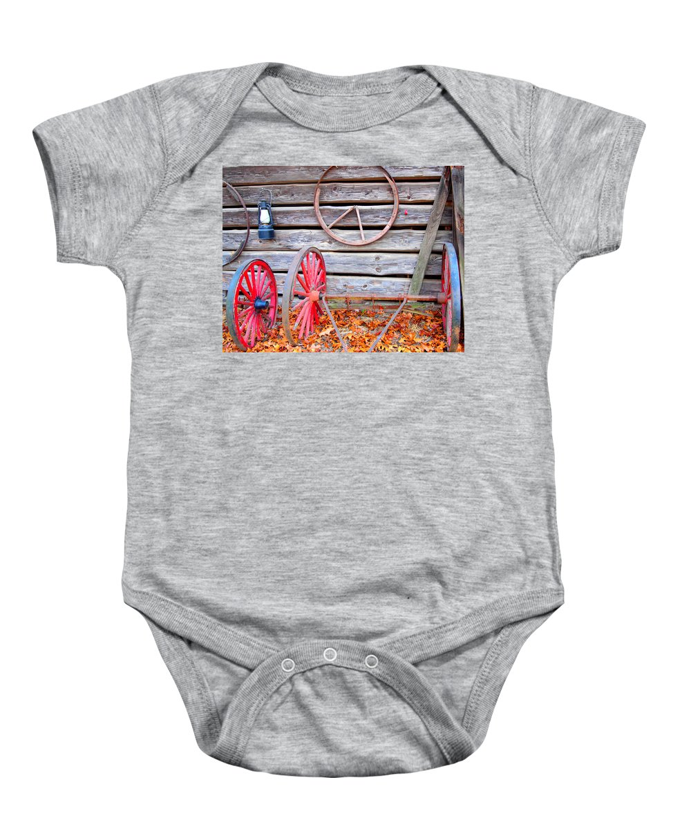 Wagon Wheels Baby Onesie featuring the photograph Wagon Wheel by Dan Sproul