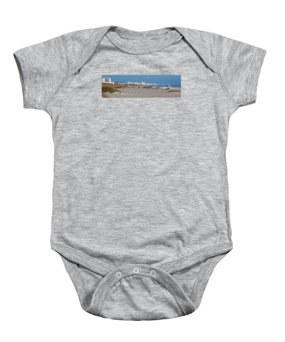 Beach Baby Onesie featuring the photograph Walking Along Cocoa Beach by Ed Gleichman