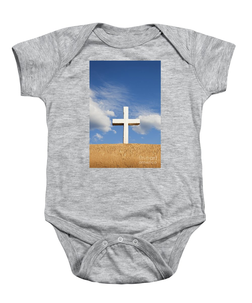 Cross Baby Onesie featuring the photograph White Cross On Adobe Wall by Bryan Mullennix