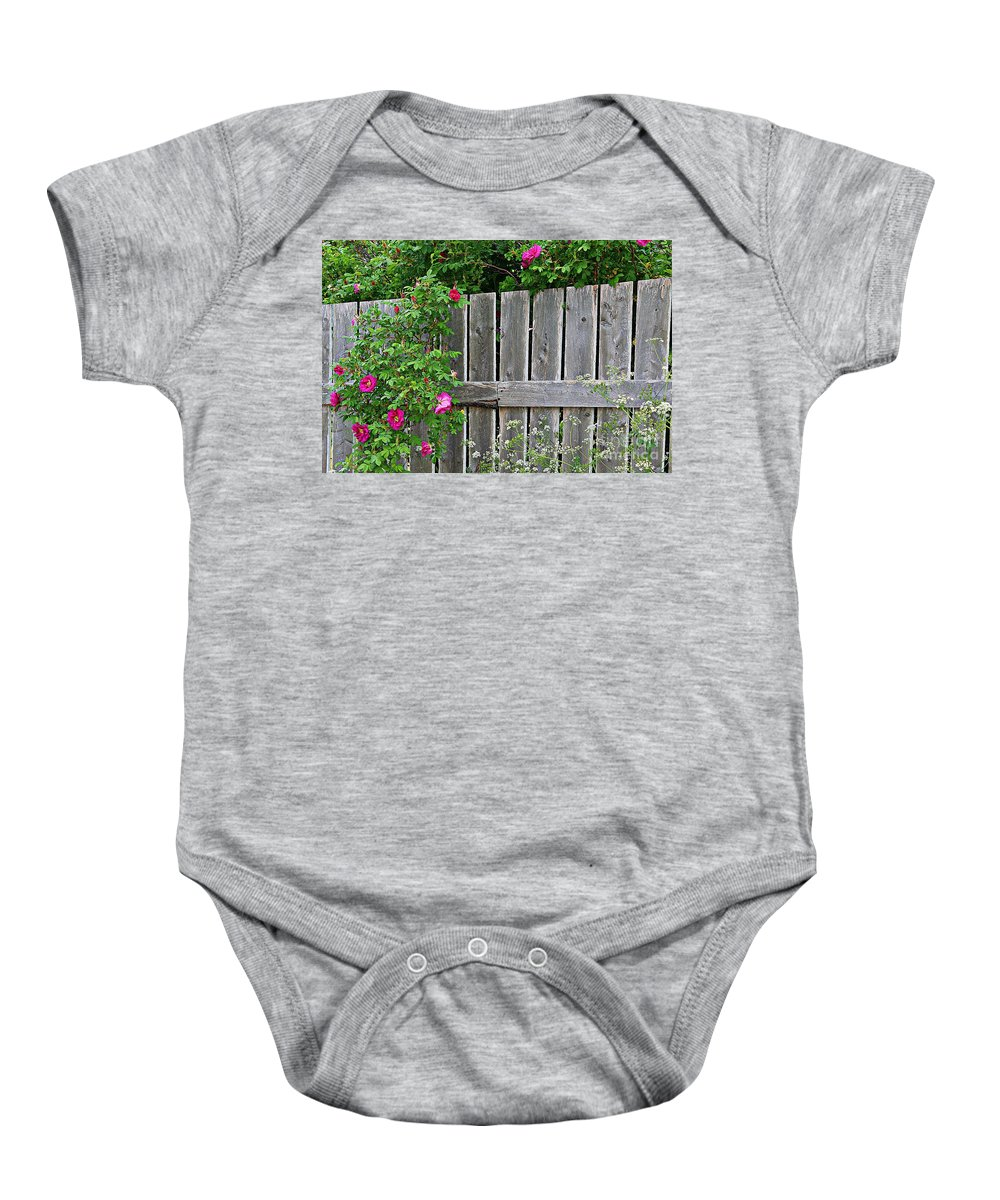 Wild Roses And Weathered Fence Baby Onesie featuring the photograph Wild Roses And Weathered Fence by Barbara Griffin