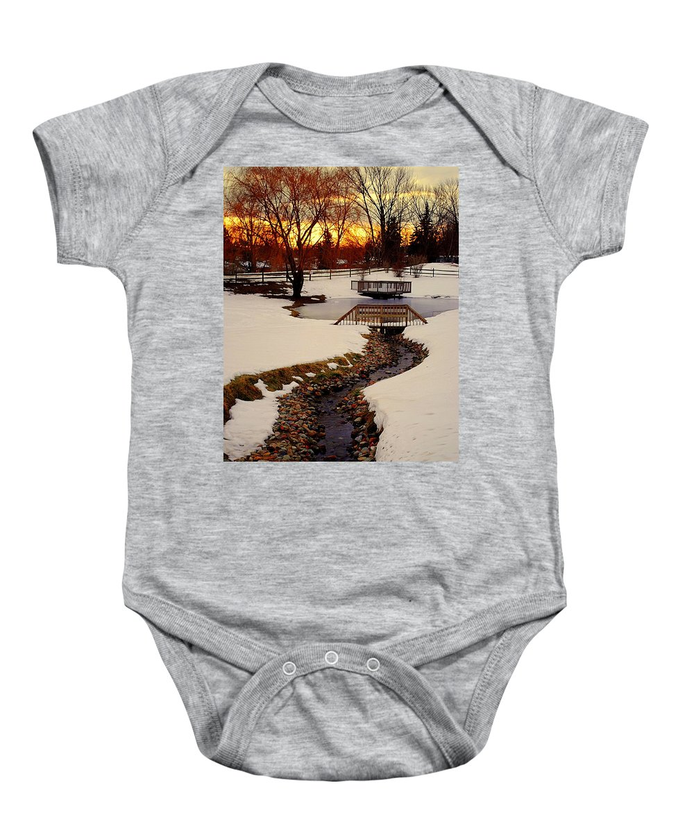 Winter Baby Onesie featuring the photograph Winters Exit by Frozen in Time Fine Art Photography