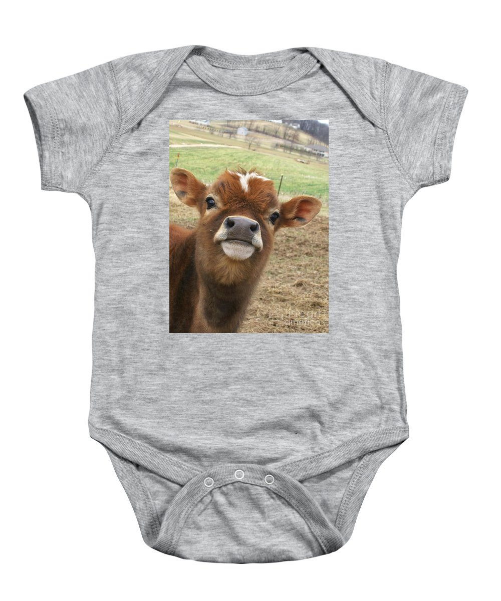 Cow Baby Onesie featuring the photograph You Looking At Me by Sara Raber