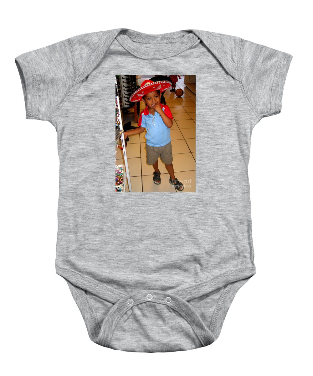 Boy Baby Onesie featuring the photograph Zihuatanjo Boy In Red Hat by Jay Milo