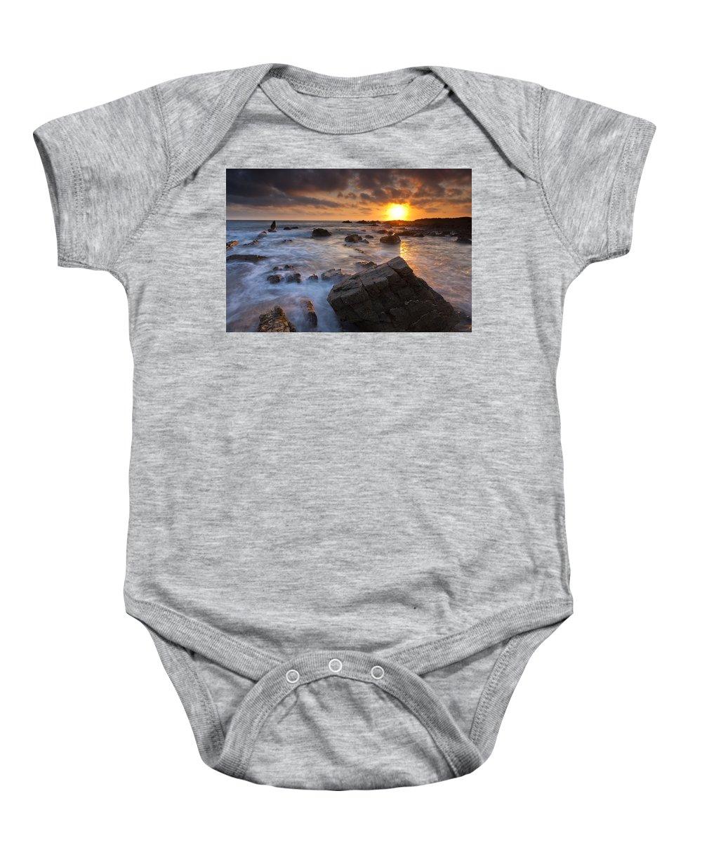 Beach Baby Onesie featuring the photograph Hartland Quay by Sebastian Wasek