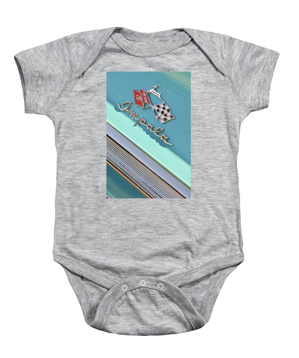 1958 Chevrolet Impala Baby Onesie featuring the photograph 1958 Chevrolet Impala Emblem by Jill Reger