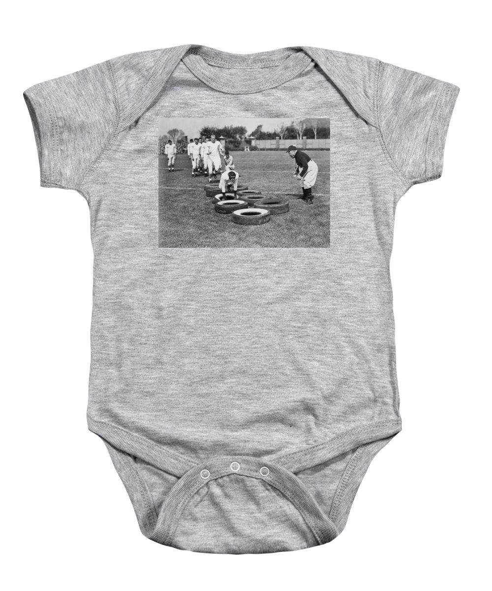-ec33- Baby Onesie featuring the photograph Silent Film Still: Sports by Granger