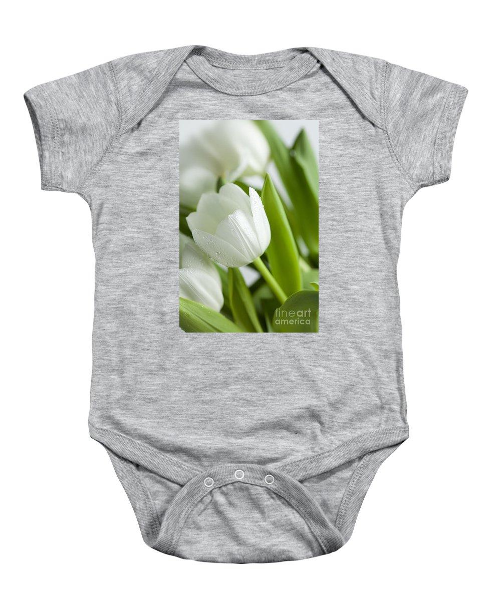 Dew Baby Onesie featuring the photograph White Tulips by Nailia Schwarz
