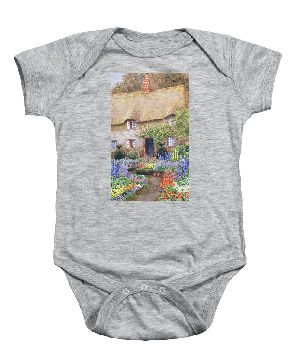 Baby Onesie featuring the painting A Cottage Garden In Full Bloom by John Henry Garlick