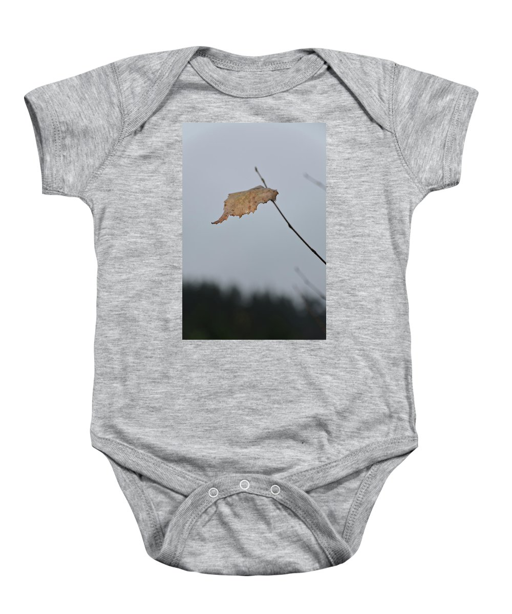 Autumn Baby Onesie featuring the photograph A Lonely Leaf by Michael Goyberg