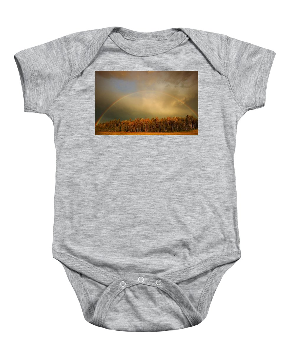 Cloud Baby Onesie featuring the photograph A Rainbow Over A Wooded Area by Don Hammond