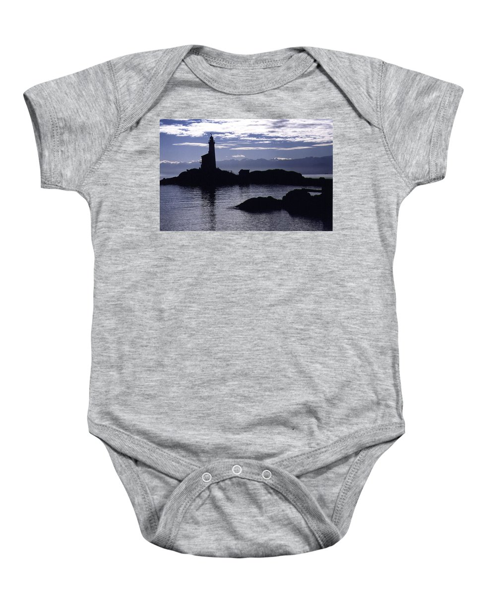 Silhouetted Baby Onesie featuring the photograph A Scenic Lighthouse by Greg Wilson