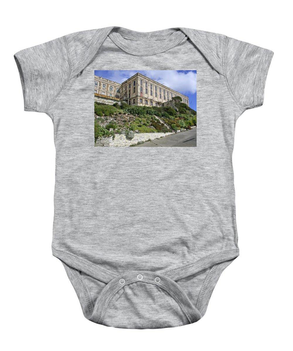 Alcatraz Baby Onesie featuring the photograph Alcatraz Cell House West Facade by Daniel Hagerman