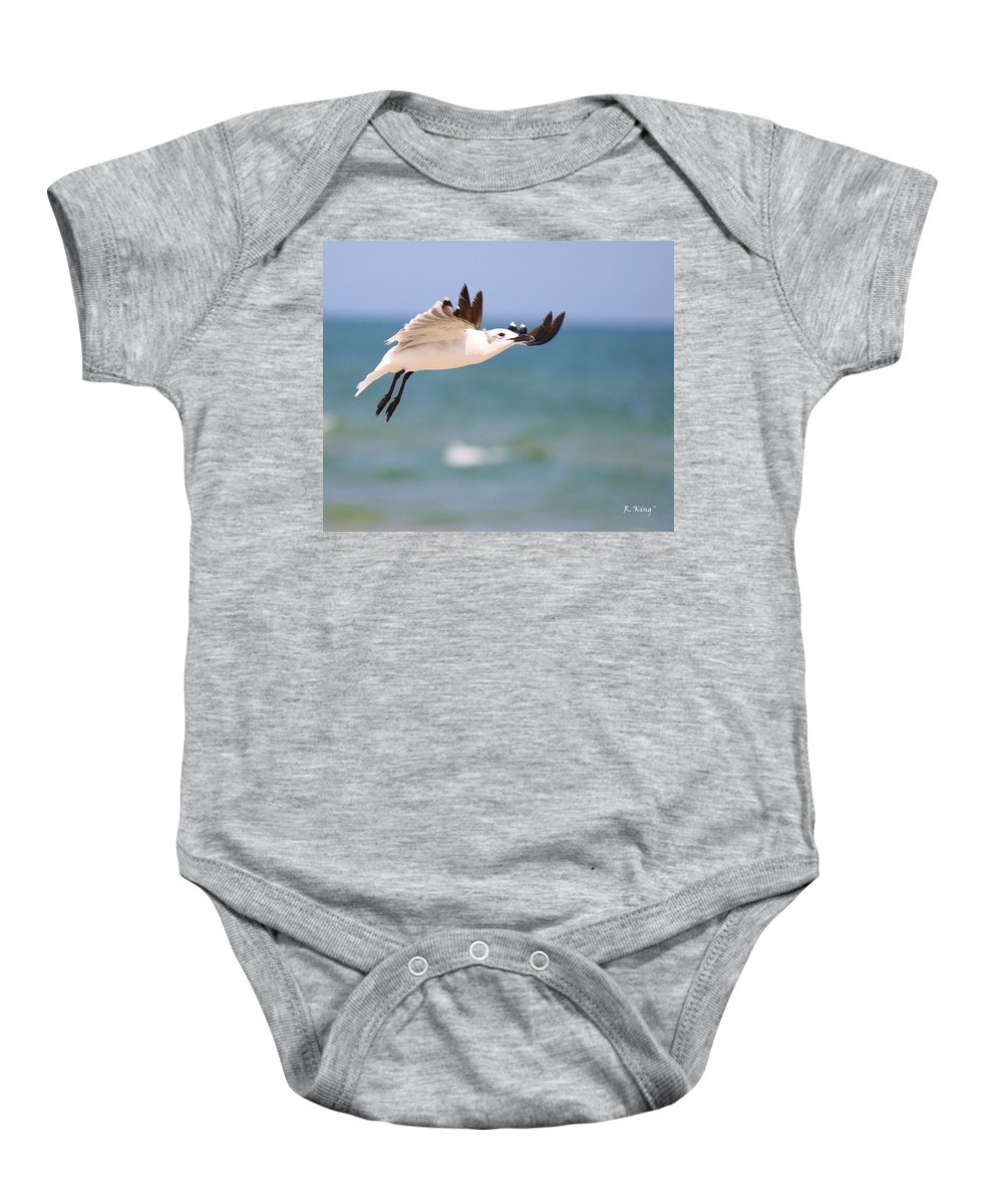 Roena King Baby Onesie featuring the photograph Ballerina Performing A Grand Jete by Roena King