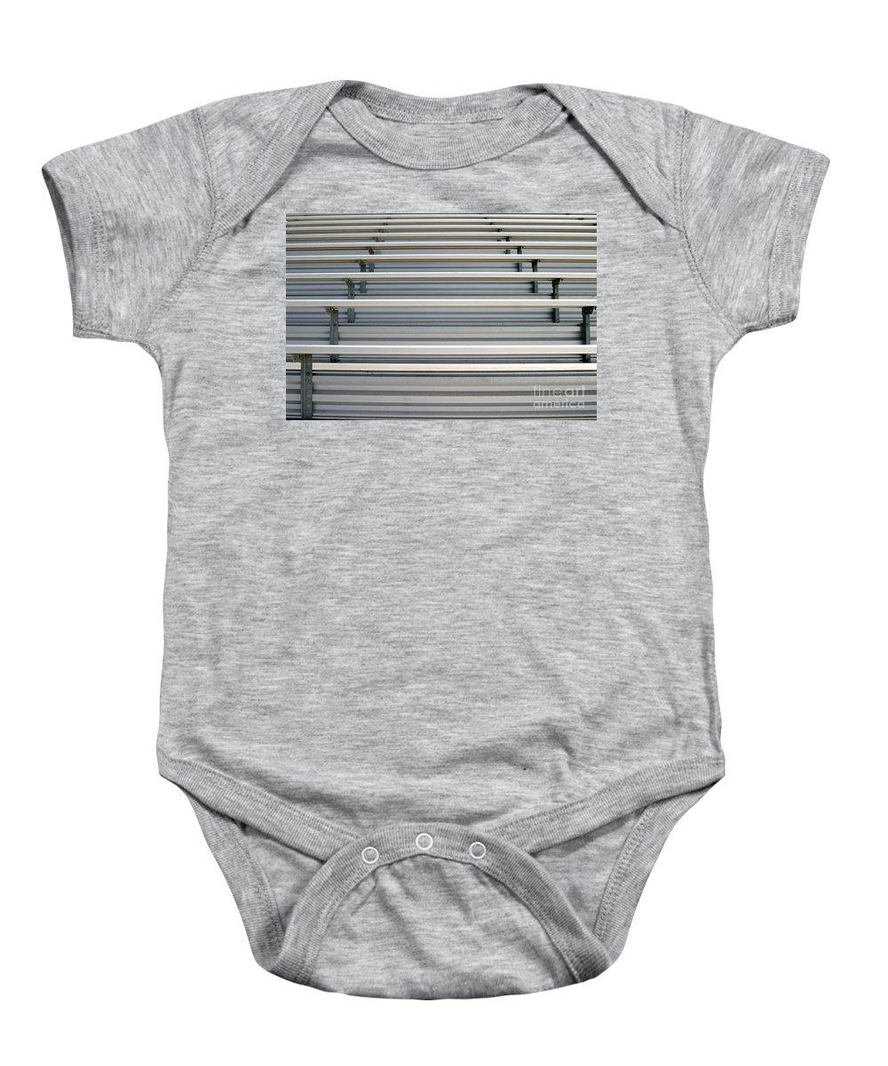 Aluminum Baby Onesie featuring the photograph Bleachers by Henrik Lehnerer
