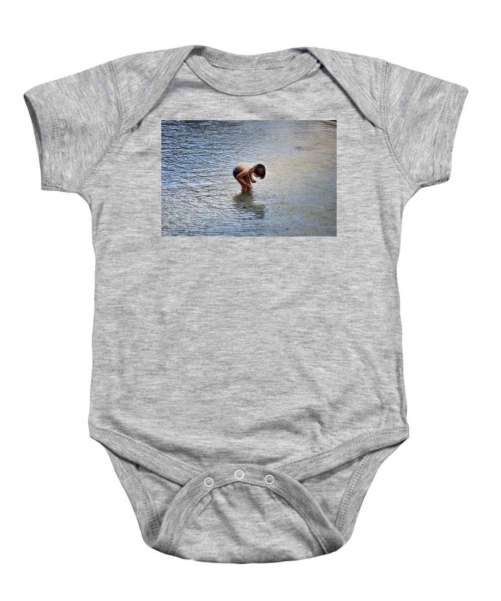 Boy Playing In Pond Baby Onesie featuring the photograph Boy Playing In The Pond by Mary Machare