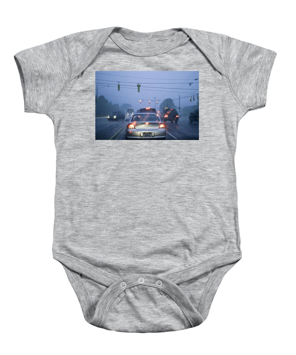 Art Baby Onesie featuring the photograph Cars And Traffic Lights In A Rain Storm by Randall Nyhof