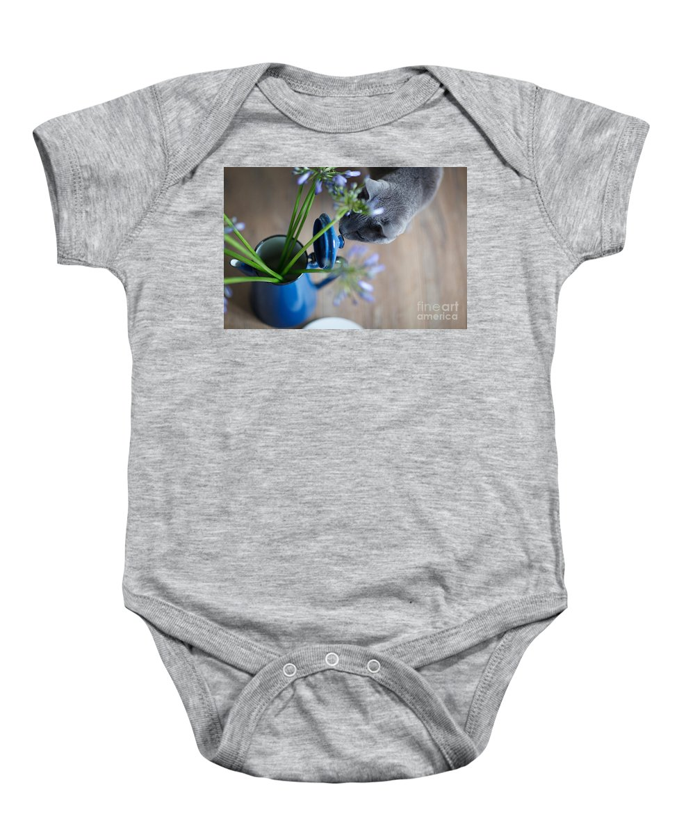 Cat Baby Onesie featuring the photograph Cat And Flowers by Nailia Schwarz