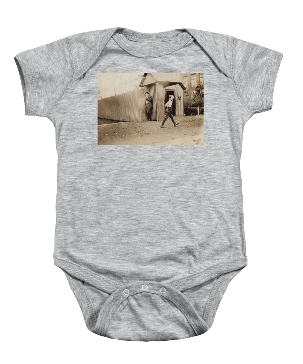 Alabama Baby Onesie featuring the photograph Child Goes To Work At Mill In Alabama - 1910 by International Images