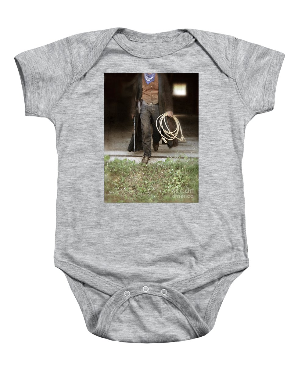 Cowboy Boots Baby Onesie featuring the photograph Cowboy With Guns And Rope by Jill Battaglia