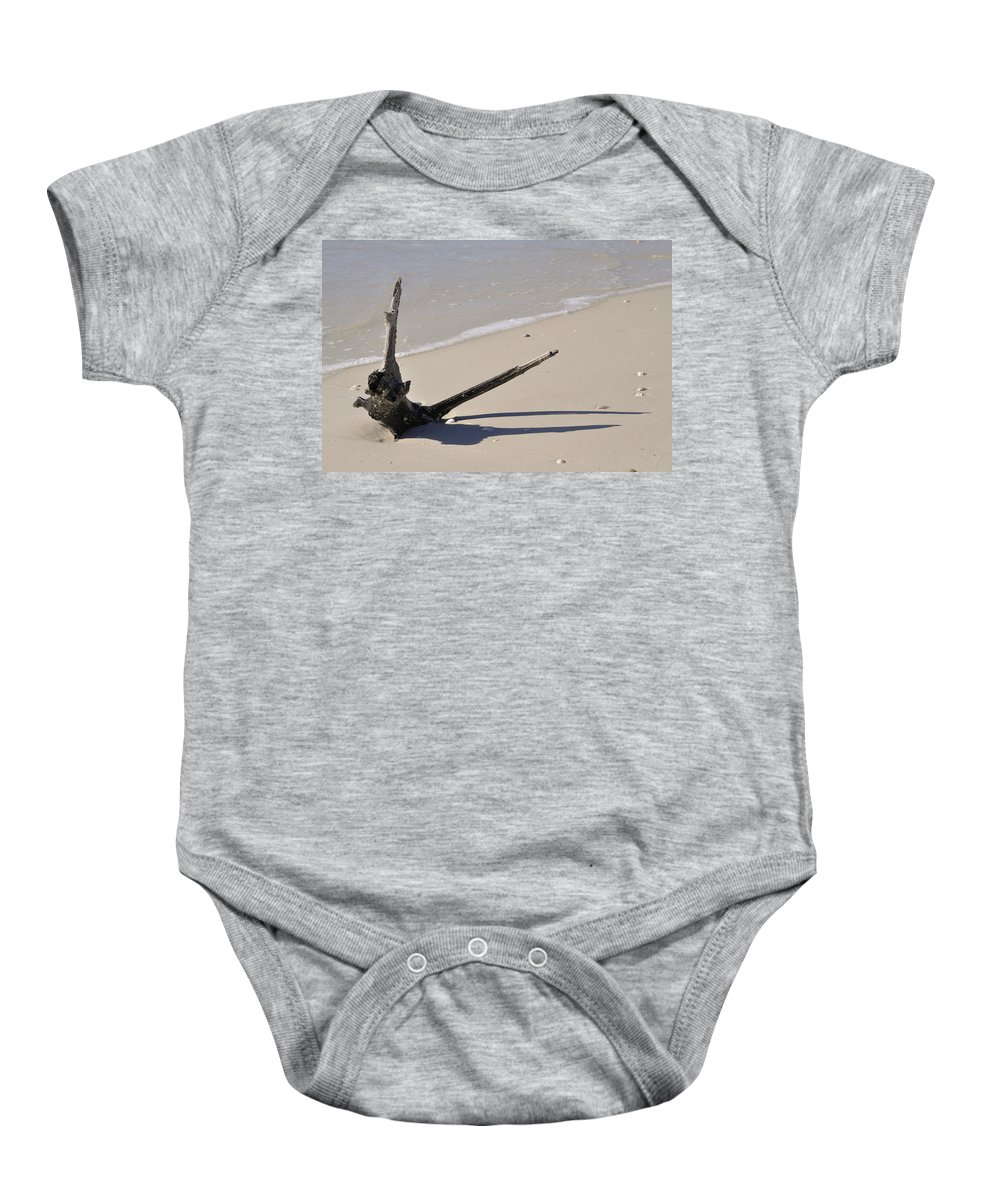 Driftwood Baby Onesie featuring the photograph Driftwood Sun Dial by Christine Stonebridge