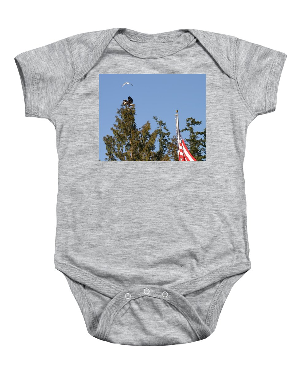 American Bald Eagle Baby Onesie featuring the photograph Eagle Rallies Round The Flagpole by Kym Backland