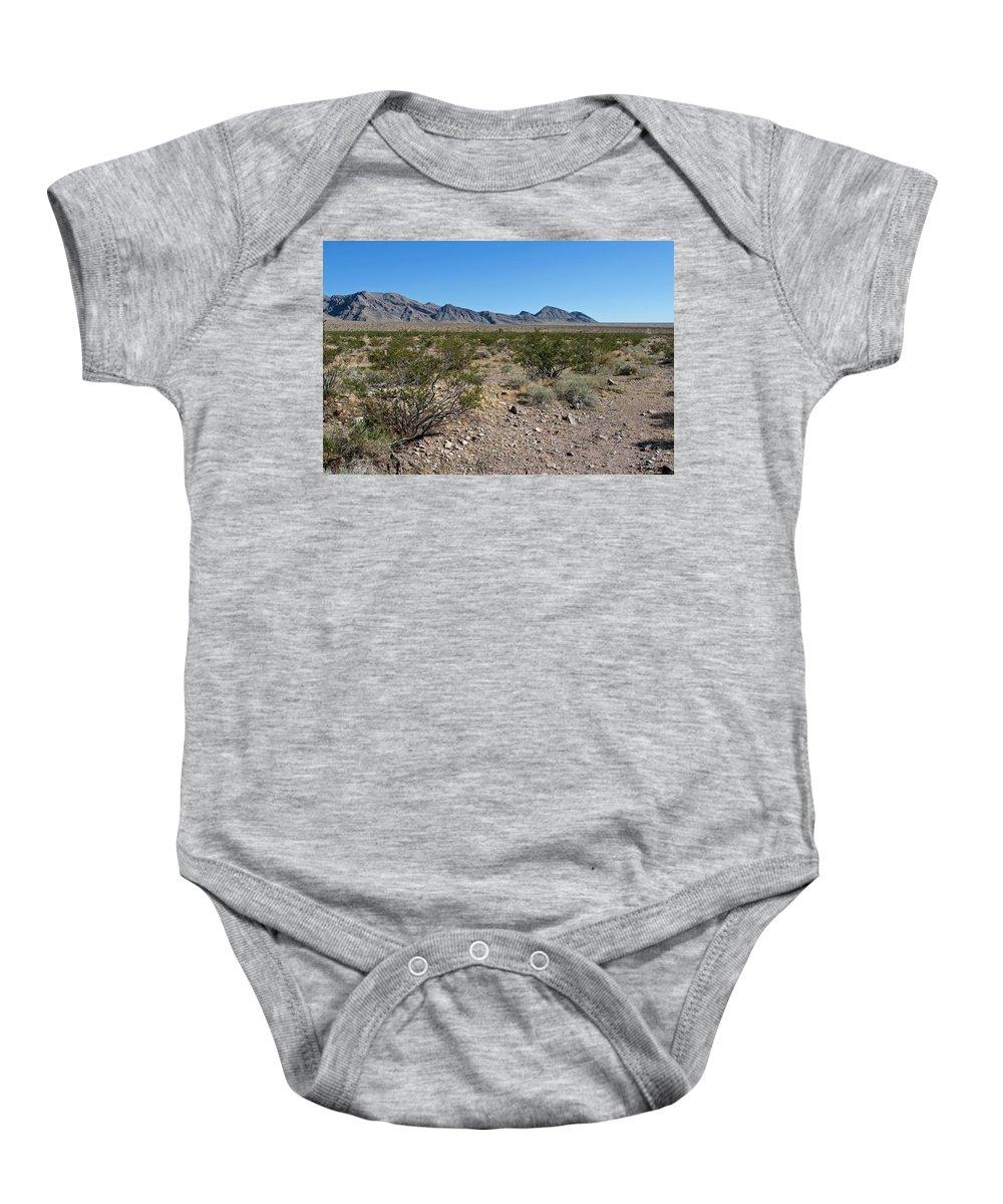 Gold Butte Region Baby Onesie featuring the photograph Gold Butte Skyline by Lorraine Devon Wilke