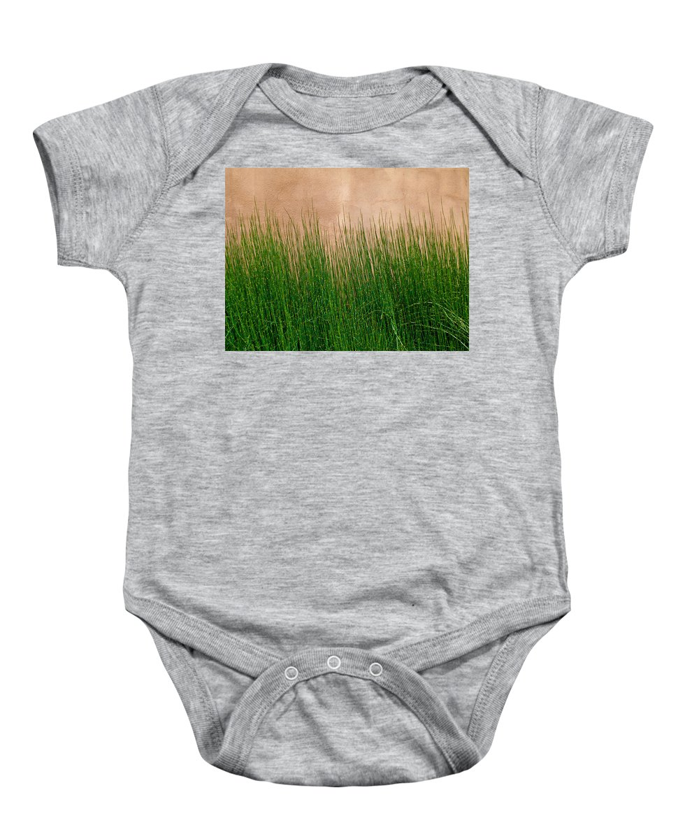 Grass Baby Onesie featuring the photograph Grass And Stucco by David Pantuso