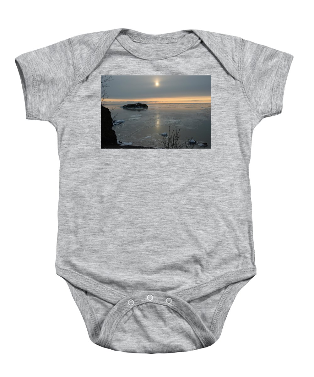 Baby Onesie featuring the photograph Icey Shore Black Beach by Joi Electa