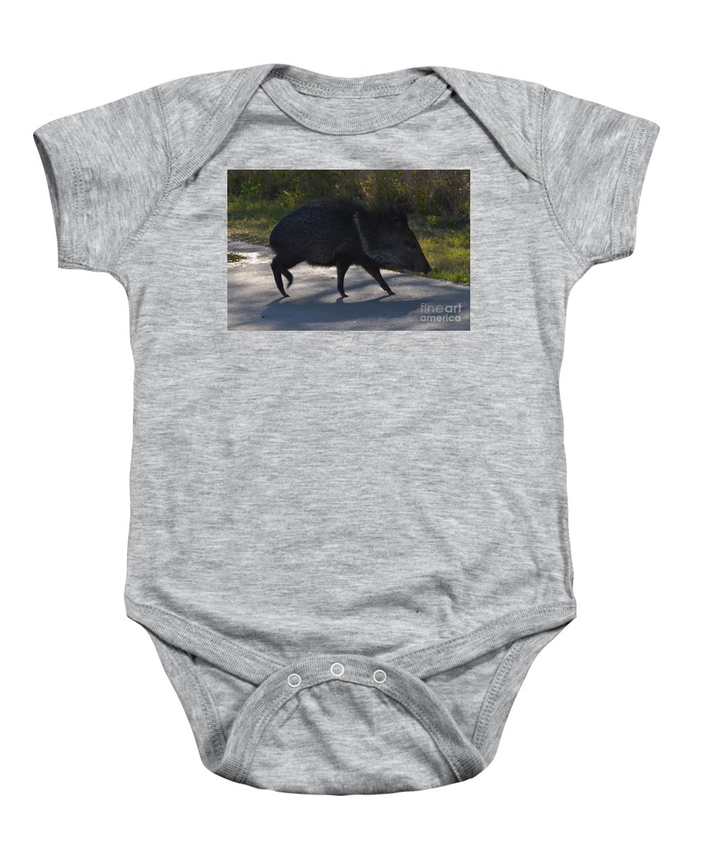 Javelina Baby Onesie featuring the photograph Javelina by Donna Brown