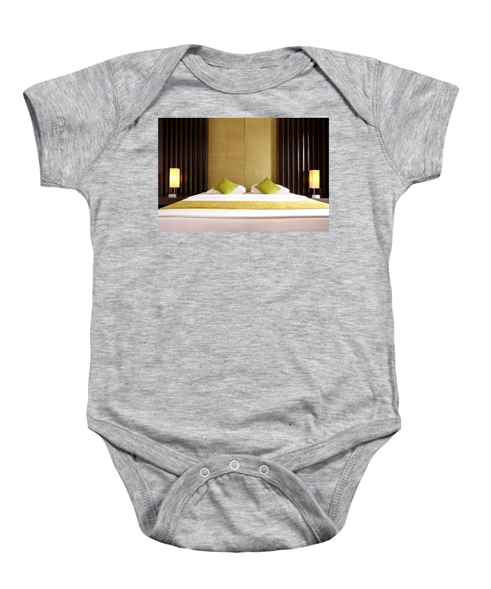 Hotel Baby Onesie featuring the photograph King Size Bed by Atiketta Sangasaeng
