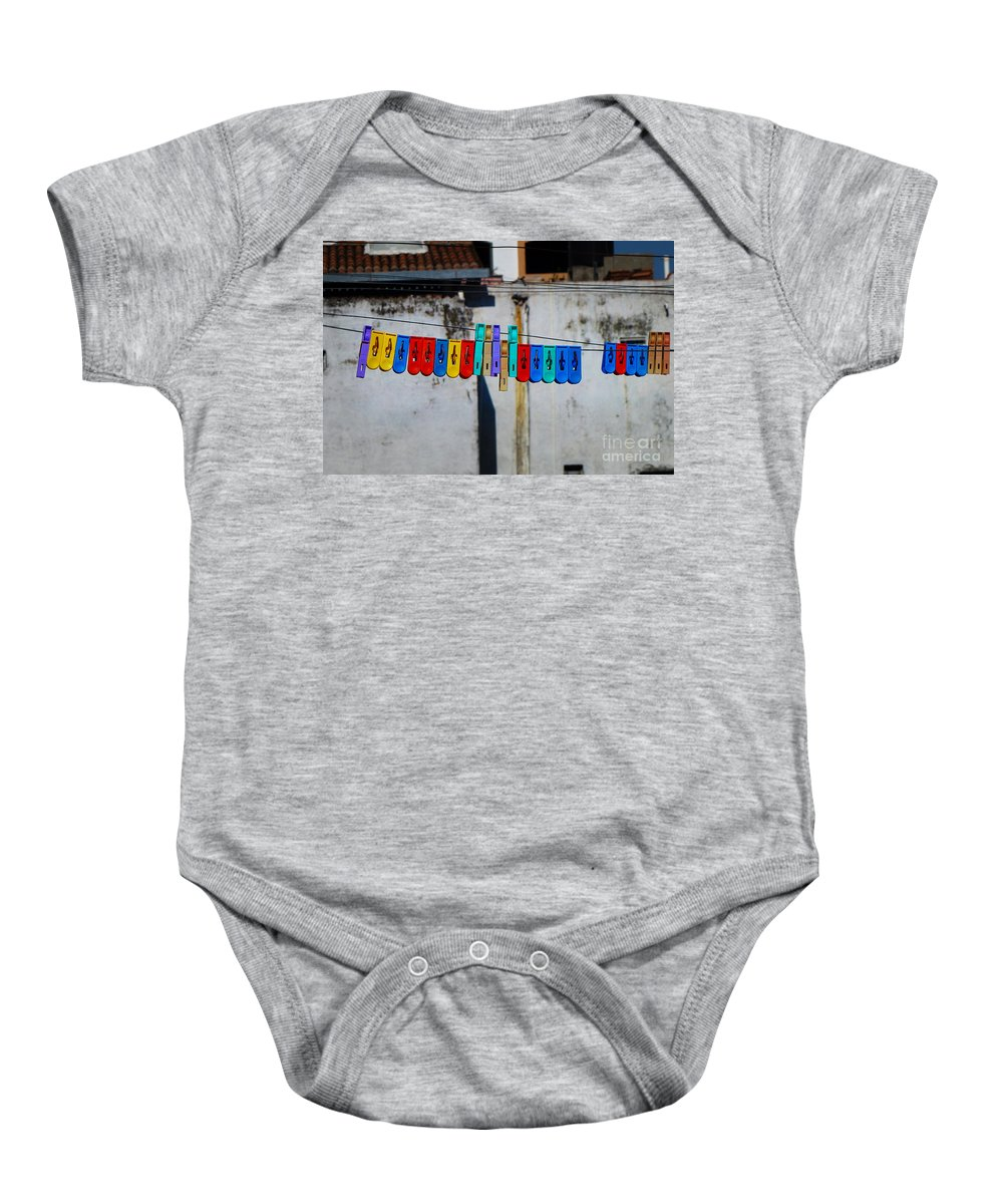 Blue Baby Onesie featuring the photograph Laundry Clips by Xueling Zou