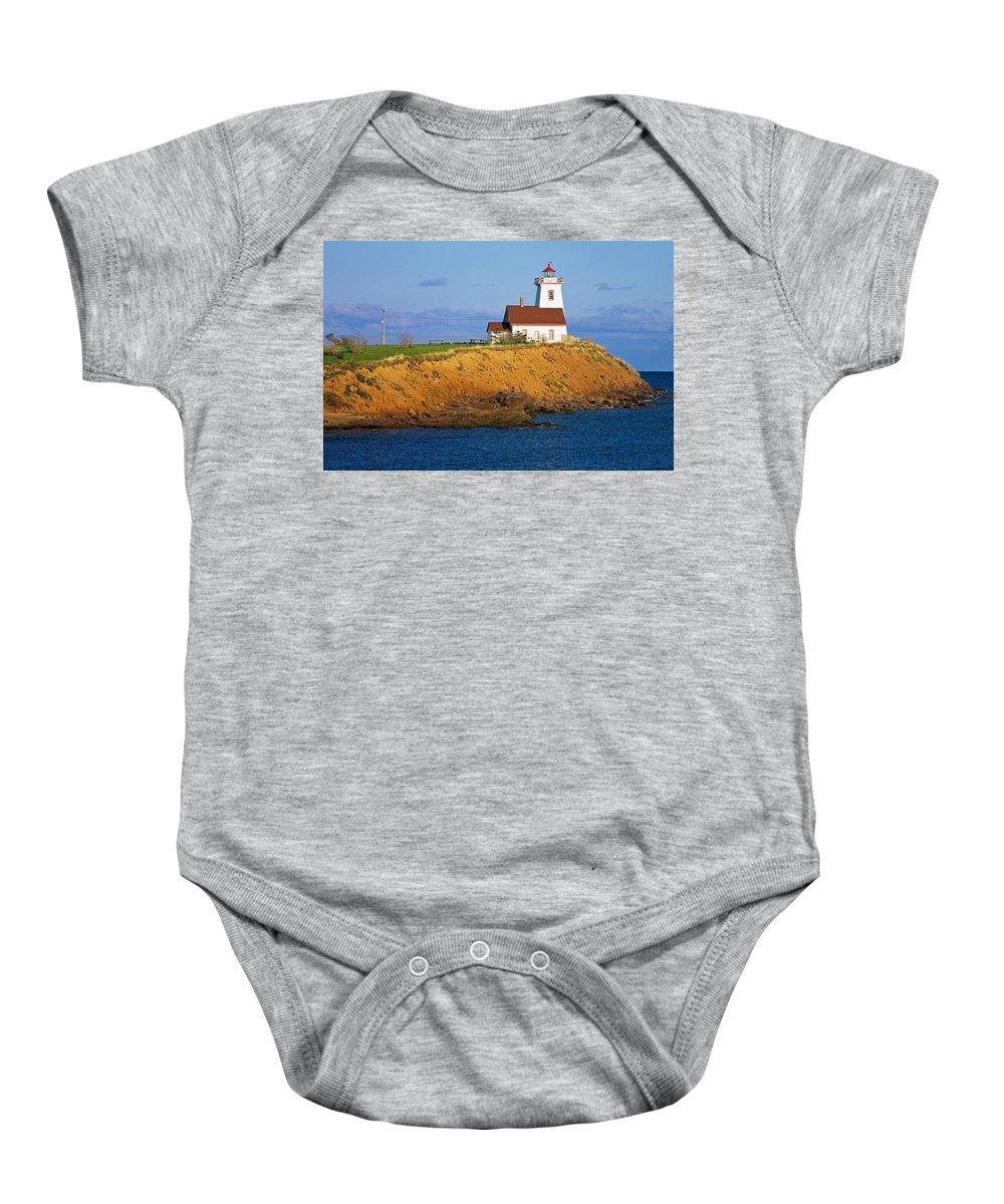 Atlantic Ocean Baby Onesie featuring the photograph Lighthouse On Prince Edward Island by Bilderbuch
