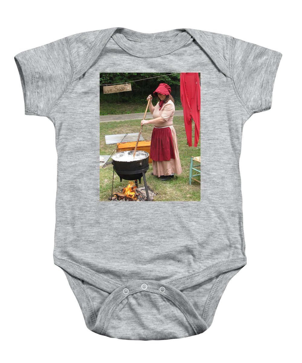 Lye Baby Onesie featuring the photograph Lye Soap Maker At Work by Kent Dunning