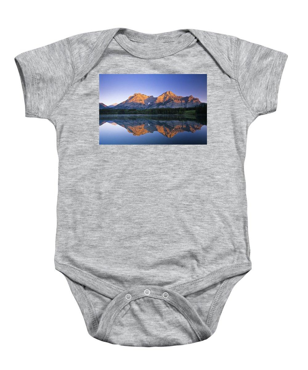 Attractions Baby Onesie featuring the photograph Mount Kidd, Wedge Pond, Kananaskis by Bilderbuch