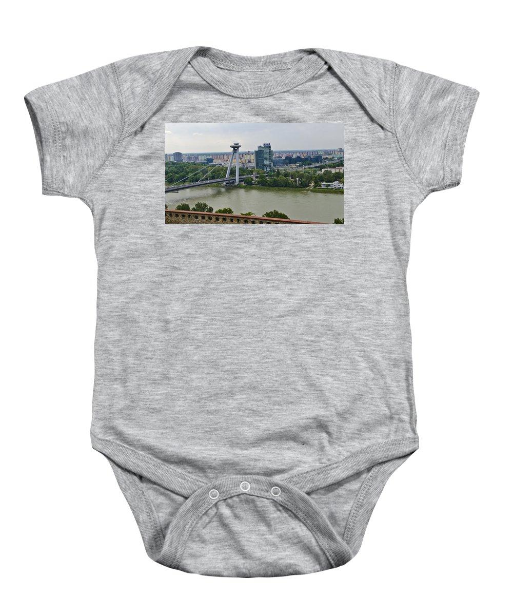 Bratislava Castle Baby Onesie featuring the photograph Novy Most Bridge - Bratislava by Jon Berghoff