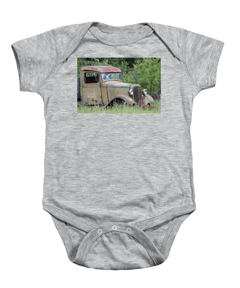 Pickup Baby Onesie featuring the photograph Abandoned Truck In Field by Athena Mckinzie