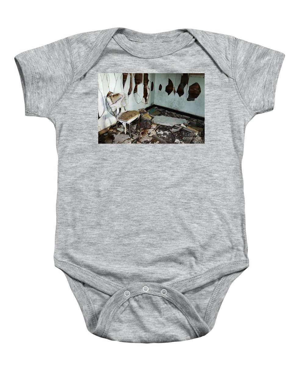 Mess Baby Onesie featuring the photograph One Mans Mess by Bob Christopher
