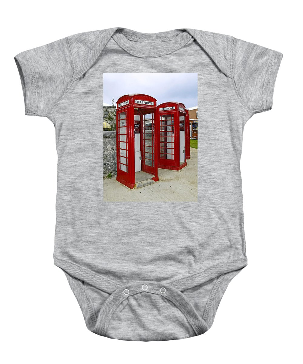 2 Red Telephone Booths Baby Onesie featuring the photograph Red Phone Booths by Sally Weigand