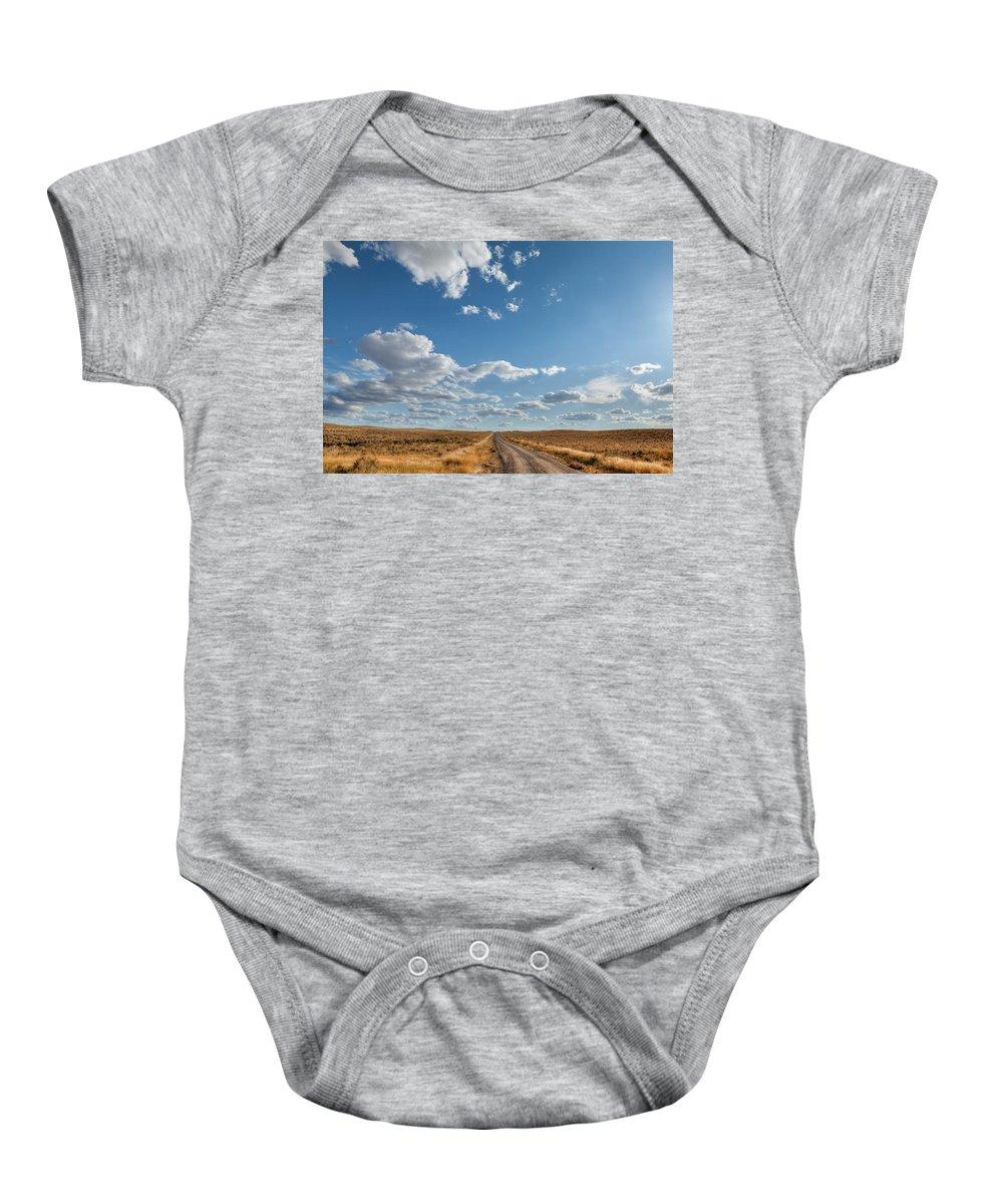 Desert Baby Onesie featuring the photograph Road Near Ten Sleep Wyoming by Steve Gadomski