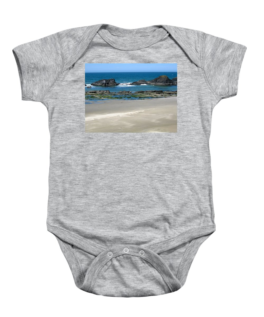 Rocks Baby Onesie featuring the photograph Rocky Coastline by Linda Hutchins